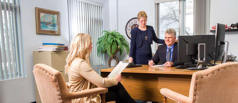 photo of karly ziebarth, karen black, david scott meeting at a desk